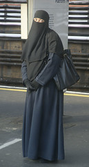 Waiting for her train, East London (ilovehijab) Tags: hijab gloves niqab abaya jilbab muslima sharshaf