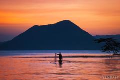 Talisay - Fishermen in Lake Taal (Yen Baet) Tags: sunset lake seascape nature water silhouette volcano boat fishing fisherman dusk philippines crater caldera manila tagaytay taalvolcano taallake talisaybatangas pcp2011