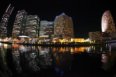 Minato Mirai at night (Spice  Trying to Catch Up!) Tags: light shadow sea urban reflection art japan night port canon buildings geotagged photography eos pier photo interesting colorful asia flickr december colours image picture vivid blogger fisheye livejournal explore photograph collections  5d inlet yokohama vox  minatomirai  2009  landmarktower  attraction gettyimages facebook  friendster multiply queenstower intercontinentalhotel    12  kanagawaken  twitter  iamge canoneos5dmarkii   twitpic