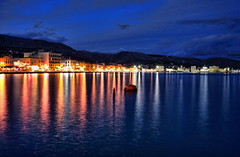 chios harbor in indigo (helen sotiriadis) Tags: blue sea sky seascape reflection water night clouds canon mom landscape island lights harbor haiti published mother indigo greece chios canonefs1022mmf3545usm canoneos40d toomanytribbles