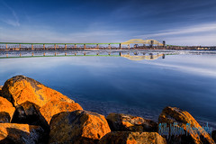 International Bridge (Billy Wilson Photography) Tags: bridge sunset sky lake ontario canada rock clouds digital canon river landscape eos rebel evening march rocks day north bluewater sunsets atmosphere xs soo hdr highdynamicrange goldenhour saultstemarie northernontario algoma waterbody billywilson
