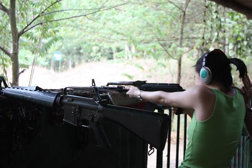 Rina shooting an AK47