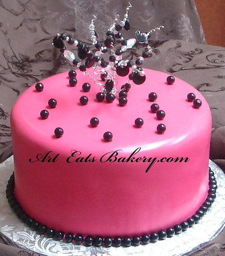 Hot pink and black fondant birthday cake with crystal topper a