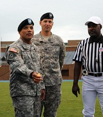 Col. Daniel Reyes initiates the pre-game coin toss (by: US Army)