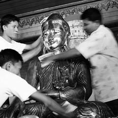 Polishing the Buddha (ndnbrunei) Tags: blackandwhite bw 120 6x6 tlr film rollei mediumformat cord southeastasia kodak shwedagon burma bn mf myanmar kodakbw400cn buddah atwork xenar rolleicord bw400cn buddhaimages analoguephotography rolleigallery ndnbrunei 50yearoldcamera ilovemyrolleicord