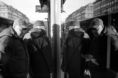 (Monsieur Marchi) Tags: people blackandwhite bw film window shop shopping shadows sweden stockholm symmetric sveavgen kodaktrix400 yashicaelectro35cc yashinon35mmf18