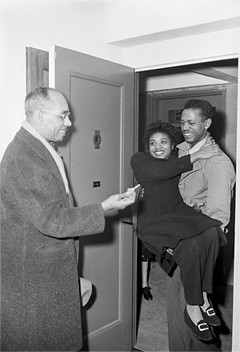 NYCHA board member Frank Crosswaith presents Mr. and Mrs. Eddie L. Riley with the key to their new apartment at Lincoln Houses, East Harlem, 1947.