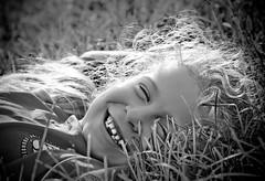 Joeli in the grass (alan shapiro photography) Tags: summer portrait bw girl monochrome mono character smiles bn canonrebel 2009 joeli alanshapiro ashapiro515 memorycornerportraits canonrebelt1i 2010alanshapiro alanshapirophotography wwwalanwshapiroblogspotcom 2010alanshapirophotography