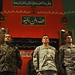 Gen. Bismillah Mohammadi, Lt. Gen. Caldwell and Spc. Mohamad Azimi rise for the playing of the Afghan National Anthem