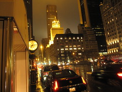 5th avenue (El Alcalde de l'Antartida) Tags: nyc newyorkcity urban cars wet rain skyline night buildings walking lights downtown nocturnal skyscrapers traffic manhattan sidewalk vehicles metropolis luci raining pioggia notte citta traffico