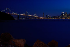 Bay Bridge and San Francisco Skyline at Blue Hour from Treasure Island (Tetrafluoromethane) Tags: sanfrancisco california longexposure lights rocks cityscape treasureisland dusk citylights baybridge sanfranciscobay bluehour sanfranciscooaklandbaybridge
