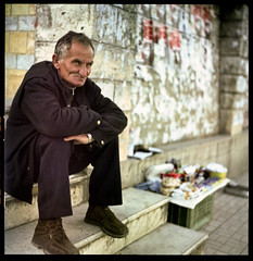 wall seller (onedayalive) Tags: life travel portrait people man art 120 6x6 film analog zeiss mediumformat square kodak photojournalism streetlife hasselblad study portraiture squareformat 500c mf analogue albania 160vc expiredfilm 214 carlzeiss hassy analoge moyenformat autaut color120 kodakcolorfilm vcfilm andrewrammingphotography andrewrammingphoto adrphotography