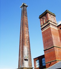 Centenary Mill chimney in Preston under repair (Tony Worrall Foto) Tags: old uk blue chimney england sky urban building tower mill industry shop architecture out jack outside workers industrial northwest north victorian lancashire steeple cotton repair sweat works scaffold preston relic insert olden lancs bygone allianceworks