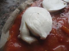 Mozarella slices on pizza