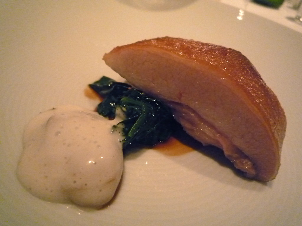 Slow cooked pork jowl with spinach and Pacific oyster