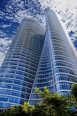 Abu Dhabi Investment Authority Tower (sminky_pinky100 (In and Out)) Tags: travel blue trees tourism architecture modern clouds angle uae perspective abudhabi tall banking tallest convergingverticals omot platinumphoto abudhabiinvestmentauthoritytower