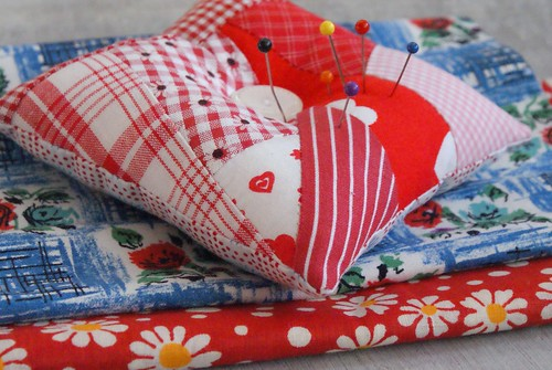 pincushion and vintage fabric