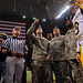Spec. David Hutchinson of the Army Reserve flips the game coin as Gen. Peter W. Chiarelli, U.S. Army Vice Chief of Staff, and Command Sgt. Maj. Dennis M. King, U.S. Army Accessions Command Command Sergeant Major.