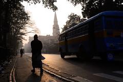 Morning (Leonid Plotkin) Tags: street morning india man bus church silhouette asia rails kolkata calcutta