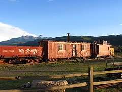 Living in an old train, USA (Pixmac-com) Tags: summer usa sun mountains nature sunshine weather truck landscapes daylight coach rocks seasons horizon unitedstatesofamerica bluesky trains nobody hills daytime summertime caravan naturalworld wagons exteriors waggons mountainpeaks summits oldtrains abandonedtrains tipofthehills livedintrain