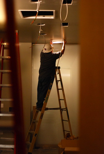 worker installing a light