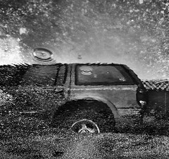 (Сина) Tags: auto uk blackandwhite bw reflection london car rain tarmac silver puddle drops grain highcontrast sigma pro vehicle asphalt suv dp1 efex