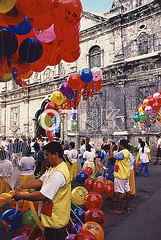 Looking for Iconic and Insightful Travel Images? (outsideboundimages) Tags: travel people church balloons asia basilica philippines culture adventure stockphotos cebu stonino vendors