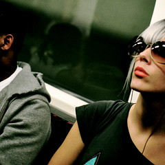 Passengers (Chris JL) Tags: street uk portrait woman color colour london underground nose iso3200 candid tube streetphotography shades lips ear redlipstick shootingfromthehip londoner neckline blondewoman areflection nikond90 coloredman nikkor35mmf18g thespacebetween2 chrisjl