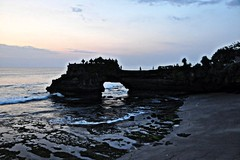 Arch at Tinah lot (rosswebsdale) Tags: bali indo seminyak indonesia tanahlot 2009 sea coast temple bintang cloud sun sunset arch rock