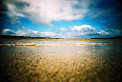 Film grain... (Trapac) Tags: uk blue sea summer film beach water clouds scotland xpro crossprocessed sand kodak lewis slidefilm plasticfantastic incomingtide 100 ripples grains elitechrome vivi vivitar uig plasticcamera isleoflewis outerhebrides 100iso floorshot kodakelitechrome wmh eb3 kodakeb3 naheileanansiar traighuig vivitarultrawideandslim ardroilsands ardroil thewesternisles uigbay vivitarws vivitaultrawideslim vivitarroll40 eadardhfhadhail gtyap1711