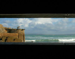Through the barricade (farwest56) Tags: wood uk travel sea england sky people holiday man water cornwall harbour wharf stives flooddefence a350