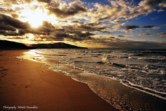 sun rays over the beach (Metatla Photography) Tags: sunset sea sky sun beach clouds landscape algeria nikon waves bleu algerie algrie azur cloudscapes tourisme skikda alger afriquedunord algria d700 vosplusbellesphotos artofimages metatlanoureddine