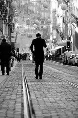 walk on... [01/52] (...storrao...) Tags: street blackandwhite bw man portugal walking nikon downtown centro streetphotography porto week1 rua baixa homem sbento caminhando d90 31dejaneiro project52 storrao sofiatorro nikond90bw ontheflyphotowalks