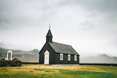 Búðir, Snæfellsnes. (Matthieu Robinet) Tags: budir iceland islande dark black church religion mountain fog cloudy rainy field cemetery gate village alone nature landscape nobody meditation arctic north summer roadtrip old snæfellsnes peninsula
