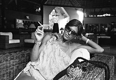 Puff (tappit_01) Tags: bw woman film mexico smoking cozumel illford nikonosv