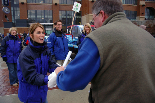WISH-TV8s Angela Buchman collects a new toy from a Colts fan outside of Lucas Oil Staduim.