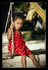 Swinging Innocence ([ Michel ]) Tags: red canon thailand thai littlegirl reddress kohchang 18270 450d canoneos450d tamron18270 tamron18270mm 18270mm