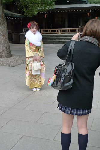 Schoolgirl takes photo of kimono girl