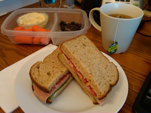 lunch: baloney on whole wheat, raisins, baby carrots w/ crab mayo, green tea