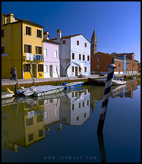Burano - San Martino's Campanile and Colored Houses on the Lagoon (Yen Baet) Tags: venice reflection water colors island europe paint italia lagoon campanile gondola venetian stillwater mirrorimage venezia leaningtower gondolier burano sunnyday vaporetto waterscape campanille paintedhouses stmartinschurch colorfulhouses carnevaledivenezia sanmartinochurch venetianlagoon nikond700 nikon2470mmf28