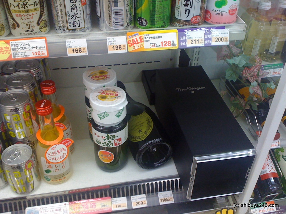 That looks like a bottle of expensive champagne lying on the shelf in this convenience store.