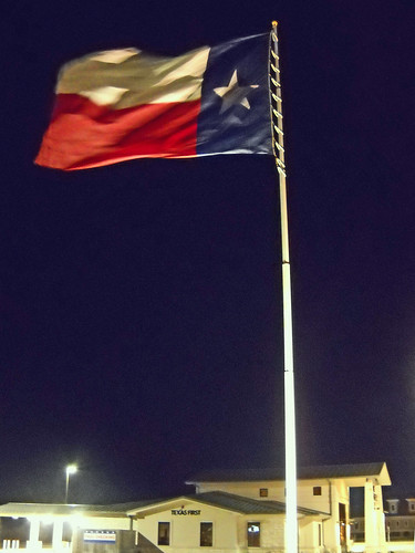 I was driving late at night from a friends house when I saw this huge Texas flag being whipped in the wind. I HAD to pull over to get a photo.