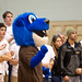 Herm, the Royals' mascot, cheers on the Runnin' Royals.