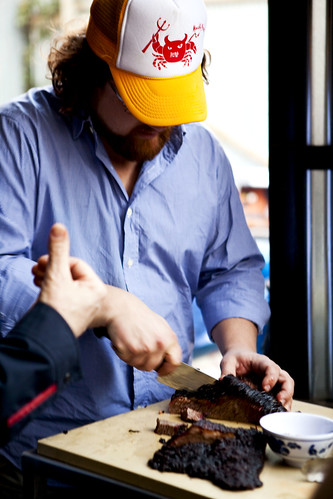 Chef/Owner of Fatty 'Cue Zakary Pelaccio cutting up brisket