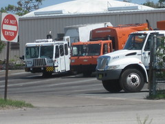 Titusville, FL - Lodal ASL, CCC / Loadmaster REL, and IHC / Grapple (FormerWMDriver) Tags: orange white trash truck garbage crane side rear company international rubbish co end ccc waste refuse loader corp load carrier industries evo rl sanitation grapple ih automated asl petersen ihc rel dustcart loadmaster rearloader durastar lodal rearload