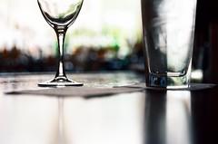 Water Before Wine (La Branaro) Tags: film bar austin restaurant glasses 1 texas dof drink kodak bokeh olympus depthoffield drinks 35mmfilm shallow wineglass om om1 enoteca kodakfilm 50mmf18 waterglass zuiko50mm kodakektar100 ektar100pushedto400 ektarpushedto400 ektarpushed pushedektar ektarpushedtwostops