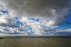 The Aftermath (Alfred Grupstra) Tags: ijsselmeer clouds lake wind andijk noordholland nederland nl nature cloudsky sea sky cloudscape blue summer water scenics outdoors landscape beach weather horizon beautyinnature nopeople horizonoverwater dramaticsky coastline sunlight
