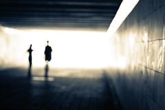 Blurry together (Che-burashka) Tags: light people urban abstract monochrome silhouette blurry couple metro citylife silhouettes tunnel ukraine romance outoffocus tunnels tgif kiev shallowdepthoffield capitalcities 400d artlibre blurpeople urbanlyric gettyskn gettyskngroup steppingintolight
