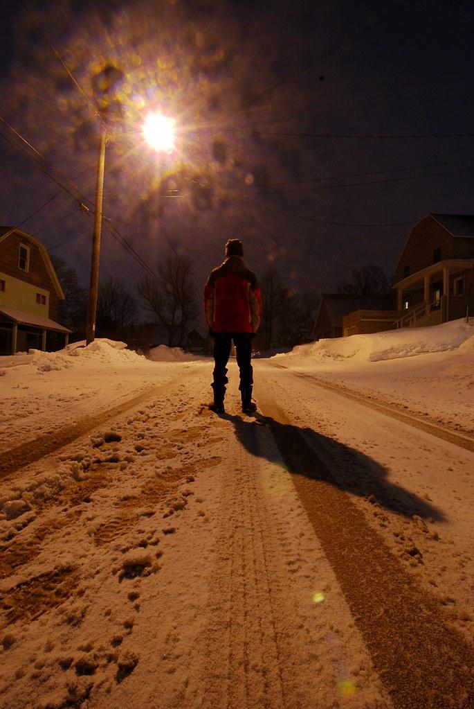 Me, standing in a dark, snowy street.