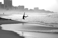 Flying high again (flavita.valsani) Tags: sea bw man reflection beach silhouette riodejaneiro sand wave pb bn explore leblon 151 somersault valsani